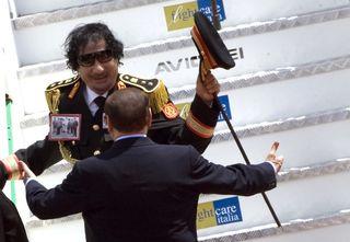 Kadhafi-3-libyan-leader-gaddafi-is-greeted-by-italy-s-pm-berlusconi-in-rome_47