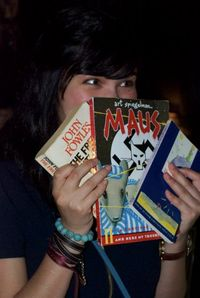 Le Carmen Nisha with books